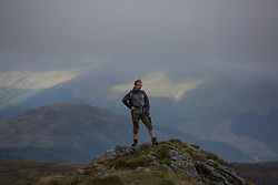 © Licensed to London News Pictures.  11/09/2021. Stirling, Scotland. A hiker on Ben Ledi near Callander, Stirling on a windy Saturday afternoon. Photo credit: Marcin Nowak/LNP