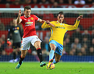 Michael Carrick of Manchester United and Marouane Chamakh of Crystal Palace battle - Manchester United vs. Crystal Palace - Barclay's Premier League - Old Trafford - Manchester - 08/11/2014 Pic Philip Oldham/Sportimage