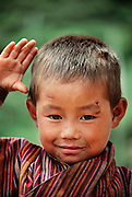 Chato Namgay, 7 years old, is Nalim and Namgay's grandson and the second son of Sangay and Sangay Kandu. Shingkhey Village, Bhutan. From Peter Menzel's Material World Project.