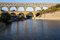 The Pont du Gard was built to allow the aqueduct of Nimes, which is almost 50 km long, to cross the Gard river. The Roman architects and engineers who designed this bridge created a technical as well as an artistic masterpiece. A true masterpiece of ancient architecture, the Pont du Gard aqueduct is one of the most beautiful Roman constructions in Europe.  The Pont du Gard was added to UNESCO World Heritage Sites in 1985.  It was designed to carry water across the Gardon river valley.  The full aqueduct had a gradient of 34 cm/km descending 17 meters in its entire length and delivering 20,000 cubic meters of water daily. Incredibly, it was constructed entirely without the use of mortar.  From the 4th century its maintenance was neglected, and deposits filled up the conduit space. Most of the Pont du Gard remains intact. The aqueduct was restored in the 18th century, by which time it had become a major tourist sight, and was restored again in the 19th century.