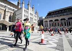 Competitors pass the Guildhall Art Gallery during the 2019 London Landmarks Half Marathon.