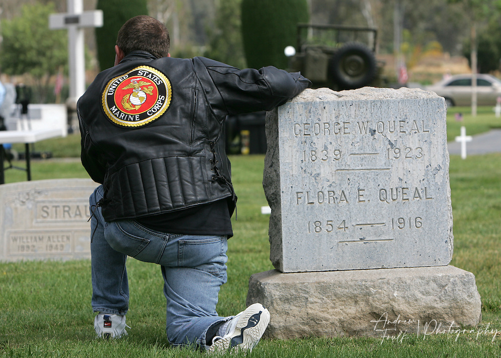 /Andrew Foulk/ For the Californian/.Marine Veteran from 1972-1999 John De-La-Torre, leans on a head stone  during the Lake Elsinore cemetery Memorial Day ceremony.