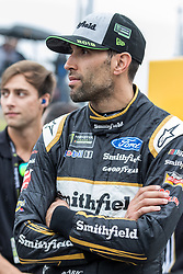 October 5, 2018 - Dover, DE, U.S. - DOVER, DE - OCTOBER 05: Aric Almirola driver of the #10 Smithfield Ford on the grid, waiting out a rain delay for qualifying for the Monster Energy NASCAR Cup Series Gander Outdoors 400 on October 05, 2018, at Dover International Speedway in Dover, DE. Qualifying was canceled after approximately a 40 minute delay. (Photo by David Hahn/Icon Sportswire) (Credit Image: © David Hahn/Icon SMI via ZUMA Press)
