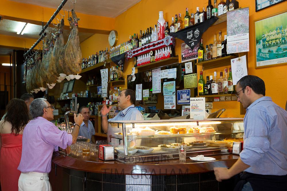 Locals in traditional Spanish tapas raciones Bar Restaurante Bikandi in central Bilbao, Spain