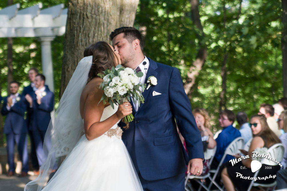 bride and groom kiss, outdoor ceremony by Tallmadge wedding photographer, Akron wedding photographer Mara Robinson Photography