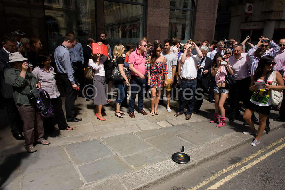Londoners experience the unexpected intensity of solar rays, reflected off one of the capital's newest skyscrapers known as the Walkie Talkie. The hotspot has surprised developers and passers-by below and which has already melted a parked car in Eastcheap Street. Thermometers placed in the street reached 144F (62 celcius) and city workers in poured out of their offices at lunchtime to experience the intense light and heat.
