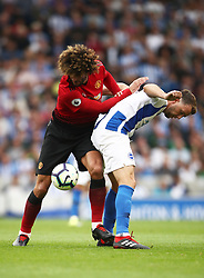 Manchester United's Marouane Fellaini (left) and Brighton & Hove Albion's Dale Stephens battle for the ball