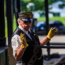 Strasburg, PA / USA - June 27, 2017:  A brakeman works in the yard at the Strasburg Rail Road station.