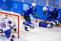 GANGNEUNG, SOUTH KOREA - FEBRUARY 20: forward Robert Sabolic #55 of Slovenia, forward David Rodman #12 of Slovenia, defenseman Henrik Odegaard #42 of Norway in action during Ice - Hockey match between National Teams of Slovenia and Norway in the Men's Play-offs Qualifications on day eleven of the PyeongChang 2018 Winter Olympic Games at Gangneung Hockey Centre on February 20, 2018 in Gangneung, South Korea.  Photo by Ronald Hoogendoorn / Sportida