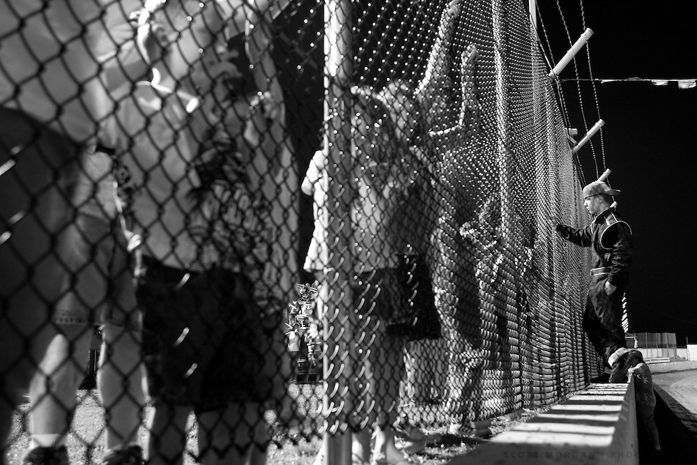 Scott Morgan/The Hawk Eye.kids watch from the fence as they have a special 40th anniversary running of classic cars and presentation on the track..Saturday July 29, 2006 at the 34 Raceway in Middletown, Iowa.