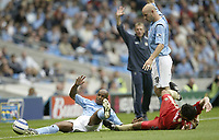 Photo: Aidan Ellis.<br /> Manchester City v Portsmouth. The Barclays Premiership.<br /> 27/08/2005.<br /> Manchester's Trevor sinclair battles to keep the ball in play with Pompy's Richard Hughes as Danny Mills and Stuart Pearce appeal for possesion