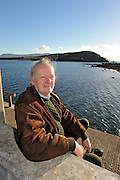 weekender: Writer, animator, composer and musician Rory Fellowes pictured on Ballinskelligs Pier with 'Horse's Island' in background in County Kerry..Picture by Don MacMonagle..Story by John O'Mahony