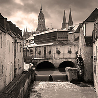 France Normandy region town of Bayeux.  View of Aure River towards the Roman Catholic church, Bayeux Cathedral.