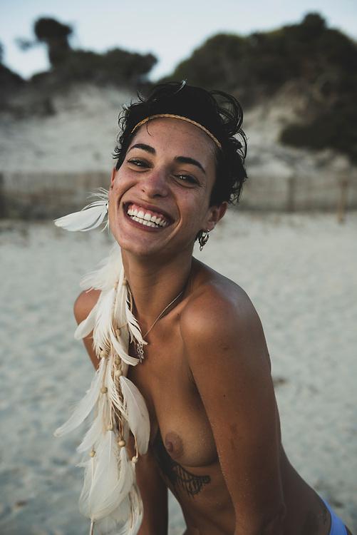 Salinas Beach, Ibiza, Spain - August 2, 2018: Pilar Montoya, from Argentina, photographed at Salinas Beach in Ibiza.