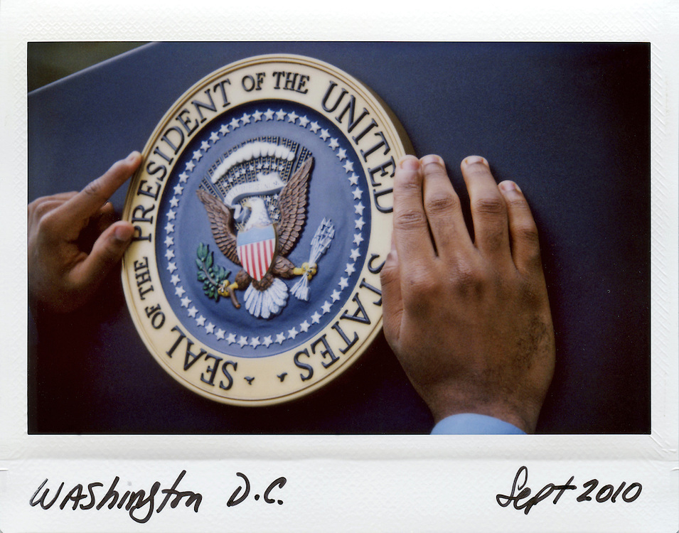 Audio-Video Specialist Doncarroll Green places the Presidential seal on to a podium prior to an event by U.S. President Barack Obama in the Rose Garden at the White House in Washington, September 17, 2010.<br /> All the images where shot with a Fuji Instax camera which produces an instant image and they were all handwritten with the date and location.