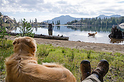 Dogs and hiker rest at Upper Kinney Lake, Toiyabe National Forest, California