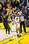 Cleveland Cavaliers forward LeBron James (23) shoots over Golden State Warriors guard Stephen Curry (30) and Golden State Warriors forward Kevon Looney (5) during Game 1 of the NBA Finals at Oracle Arena in Oakland, Calif., on May 31, 2018. (Stan Olszewski/Special to S.F. Examiner)