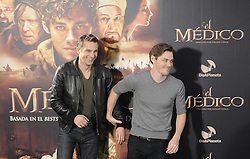 (L-R)  Olivier Martinez and Tom Payne  attends 'The Physician' photocall on December 19, 2013 in Madrid, Spain. Picture by DyD Fotografos / i-Images.<br /> <br /> SPAIN OUT