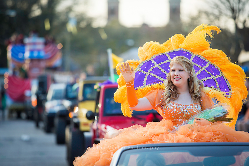 """The Krewe of Ambrosia maid Tori Berger greets the mardi gras crowd as the Krewe parades from Nicholls State University and through downtown Thibodaux, La. The 2016 parade is themed, """"Ambrosia on Top of the World"""".  The mardi gras parade features 17 double decker floats, 4 dance groups and 6 marching bands."""