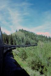 Train Winding Through Hills