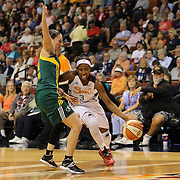 Allison Hightower, (right), Connecticut Sun, drives past Sue Bird, Seattle Storm, during the Connecticut Sun Vs Seattle Storm WNBA regular season game at Mohegan Sun Arena, Uncasville, Connecticut, USA. 23rd May 2014. Photo Tim Clayton