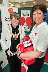 """Lord Mayor of Sheffield Councillor Dr Sylvia Dunkley & British Lung Foundation Support & Development Manager help to launch of the """"Winning The Fight For Breath  with COPD Campaign"""" in Meadowhall Shopping Centre Sheffield on Saturday 18th February 2012..www.pauldaviddrabble.co.uk..18th February 2012 -  Image © Paul David Drabble"""