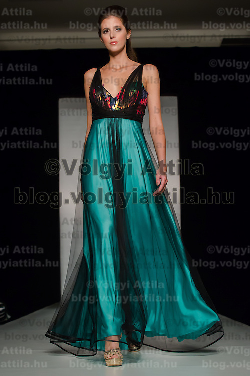 Model presents a creation part of the Maison Marquise collection by Hungarian fashion designer Bori Toth in Budapest, Hungary on May 28, 2013. ATTILA VOLGYI