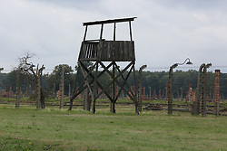 A guard tower with barbed wire fences at the Auschwitz-Birkenau Nazi concentration camps in Auschwitz, Poland on September 3, 2017. Auschwitz concentration camp was a network of German Nazi concentration camps and extermination camps built and operated by the Third Reich in Polish areas annexed by Nazi Germany during WWII. It consisted of Auschwitz I (the original camp), Auschwitz II–Birkenau (a combination concentration/extermination camp), Auschwitz II–Monowitz (a labor camp to staff an IG Farben factory), and 45 satellite camps. In September 1941, Auschwitz II–Birkenau went on to become a major site of the Nazi Final Solution to the Jewish Question. From early 1942 until late 1944, transport trains delivered Jews to the camp's gas chambers from all over German-occupied Europe, where they were killed en masse with the pesticide Zyklon B. An estimated 1.3 million people were sent to the camp, of whom at least 1.1million died. Around 90 percent of those killed were Jewish; approximately 1 in 6 Jews killed in the Holocaust died at the camp. Others deported to Auschwitz included 150,000 Poles, 23,000 Romani and Sinti, 15,000 Soviet prisoners of war, 400 Jehovah's Witnesses, and tens of thousands of others of diverse nationalities, including an unknown number of homosexuals. Many of those not killed in the gas chambers died of starvation, forced labor, infectious diseases, individual executions, and medical experiments. In 1947, Poland founded a museum on the site of Auschwitz I and II, and in 1979, it was named a UNESCO World Heritage Site. Photo by Somer/ABACAPRESS.COM