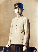 vintage portrait of a young adult boy wearing a school uniform Japan