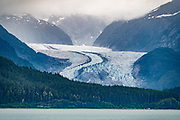 Mendenhall Glacier, Juneau, Alaska, USA. Photographed from the ferry (Alaska Marine Highway System) southbound from Haines to Juneau. Mendenhall Glacier Recreation Area is a unit of Tongass National Forest. Mendenhall Glacier has retreated 1.75 miles since 1929, when Mendenhall Lake was created, and over 2.5 miles (4.0 km) since 1500. Since the mid 1900s, Alaska has warmed 3 degrees Fahrenheit and its winters have warmed nearly 6 degrees. Human-caused climate change induced by emissions of greenhouse gases continues to accelerate the warming of Alaska at an unprecedented rate. Climate change is having disproportionate effects in the Arctic, which is heating up twice as fast as the rest of Earth.