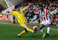 Craig Braham-Barrett attempts a cross during the Sky Bet League 2 match between Cheltenham Town and Plymouth Argyle at Whaddon Road, Cheltenham, England on 28 March 2015. Photo by Alan Franklin.