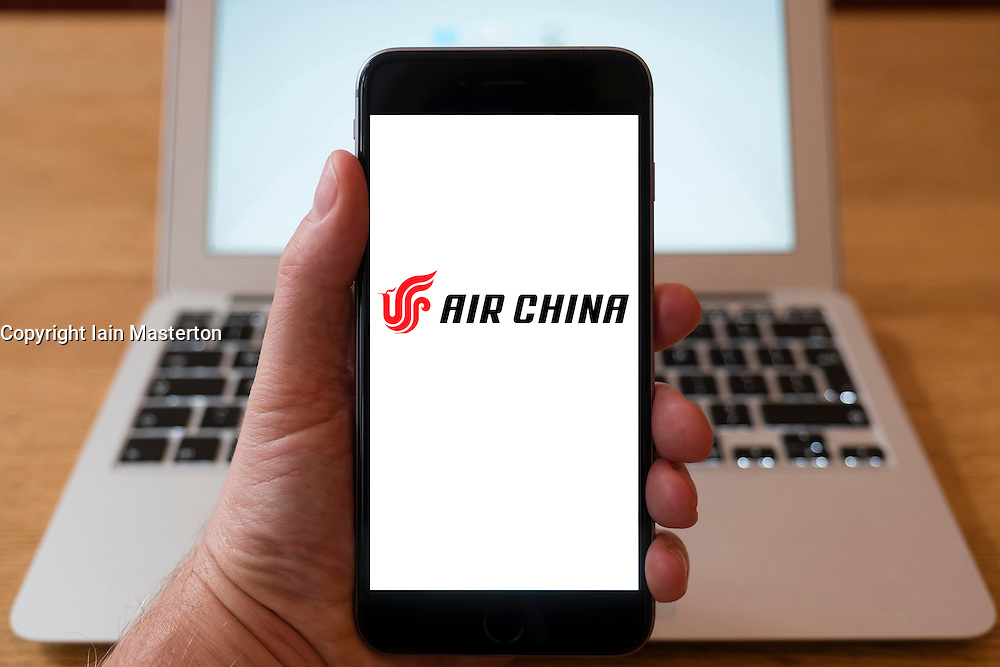 Using iPhone smartphone to display logo of Air China Chinese national carrier