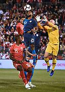 United States' Kellyn Acosta (23) deflects a corner kick by Peru as United States goalkeeper Brad Guzan (1) defends and Peru's Christian Ramos (15) looks on during the first half of an international friendly soccer match in East Hartford, Conn., Tuesday, Oct. 16, 2018. (AP Photo/Jessica Hill)