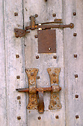 Detail of rusty old lock and bolt at the medieval Chateau de Rully in Cote Chalonnaise, Bourgogne.
