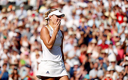 Angelique Kerber celebrates her win against Serena Williams on day twelve of the Wimbledon Championships at the All England Lawn Tennis and Croquet Club, Wimbledon.