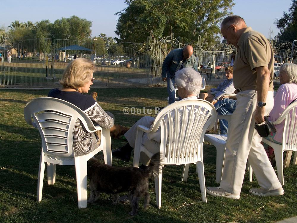 senior people gathering in a dog run USA
