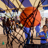 Kirah Thomas takes a turn at a basketball contest during the Ashkii Happy Kids Day event at the Navajo Nation Fair in Window Rock Thursday.
