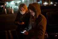 Members of the host network communicate with each other as they wait in case a migrant comes on the night bus. Irun (Basque Country). February 12, 2019. A group of volunteers has created a host network to serve migrants and inform about the public services they are entitled to and the ways to cross the border. This group of volunteers is avoiding a serious humanitarian problem Irun, the Basque municipality on the border with Hendaye. As the number of migrants arriving on the coasts of southern Spain incresead, more and more migrants are heading north to the border city of Irun. One of the functions performed by these volunteers is to direct the newcomers to the centre the red cross has for migrants in transit, so that they can sleep in a safe place. (Gari Garaialde / Bostok Photo).