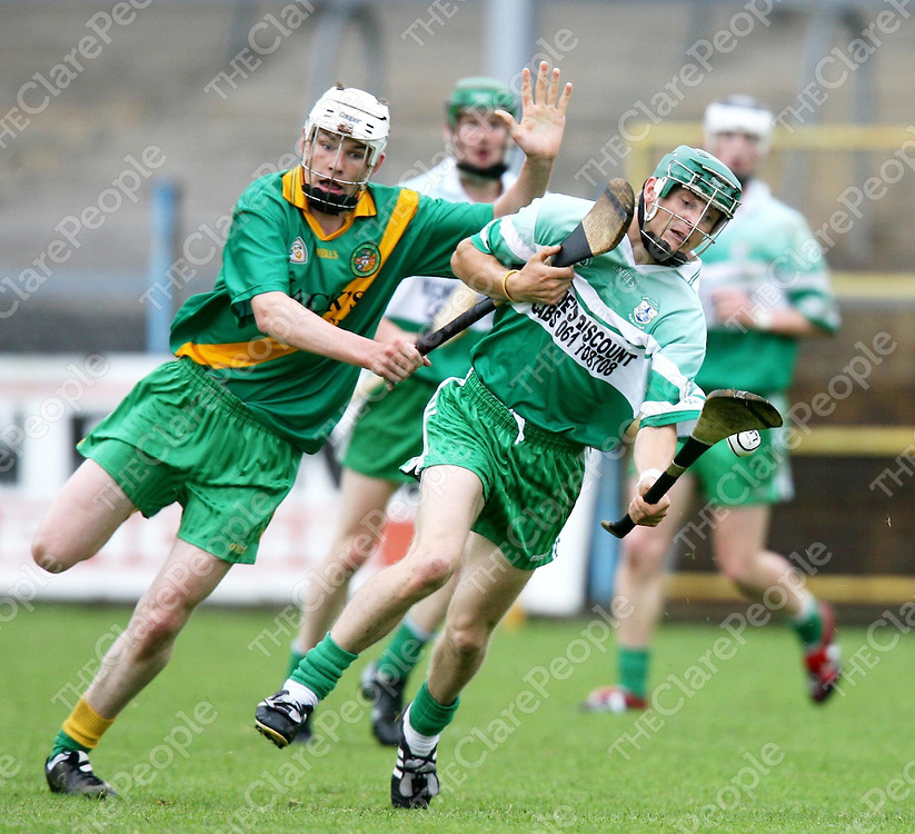 Daithi O'Connell and Diarmuid Hehir in action during the Wolfe Tones V O'Callaghans Mills senior hurling championship match at Cusack Park on Wednesday evening.<br /> <br /> Photograph by Eamon Ward