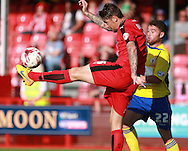 Crawley Town central defender Sonny Bradley clears under pressure from Accrington Stanley defender Adam Buxton during the Sky Bet League 2 match between Crawley Town and Accrington Stanley at the Checkatrade.com Stadium, Crawley, England on 26 September 2015. Photo by Bennett Dean.