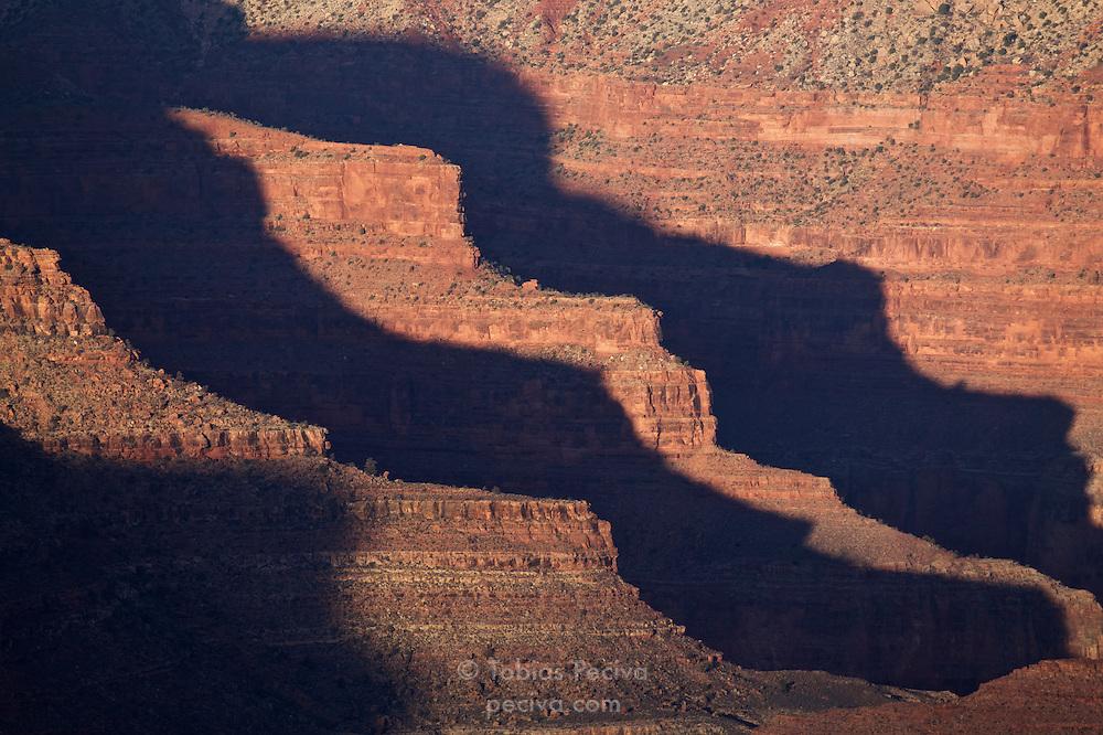 Narrow rock outcrops cast early morning shadows in Grand Canyon National Park, Arizona.