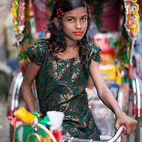 A young girl on a rickshaw in the Outfall Slum, Dhaka