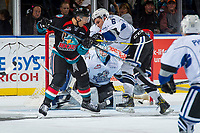 KELOWNA, CANADA - OCTOBER 4: \Carsen Twarynski #18 of the Kelowna Rockets is checked by Jeremy Masella #6 as Griffen Outhouse #30 of the Victoria Royals makes a save on October 4, 2017 at Prospera Place in Kelowna, British Columbia, Canada.  (Photo by Marissa Baecker/Shoot the Breeze)  *** Local Caption ***