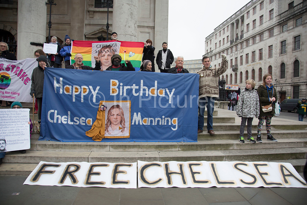 Demonstration for Chelsea Manning in London, England, United Kingdom. Chelsea Manning (born Bradley Edward Manning) is a United States Army soldier who was convicted by court-martial in July 2013 of violations of the Espionage Act and other offenses, after disclosing to WikiLeaks nearly three-quarters of a million classified or unclassified but sensitive military and diplomatic documents. Manning was sentenced in August 2013 to 35 years imprisonment, with the possibility of parole in the eighth year, and to be dishonorably discharged from the Army. Manning is a trans woman who, in a statement the day after sentencing, said she had felt female since childhood, wanted to be known as Chelsea, and desired to begin hormone replacement therapy. From early life and through much of her Army life, Manning was known as Bradley; she was diagnosed with gender identity disorder while in the Army. (photo by Mike Kemp/In Pictures via Getty Images)