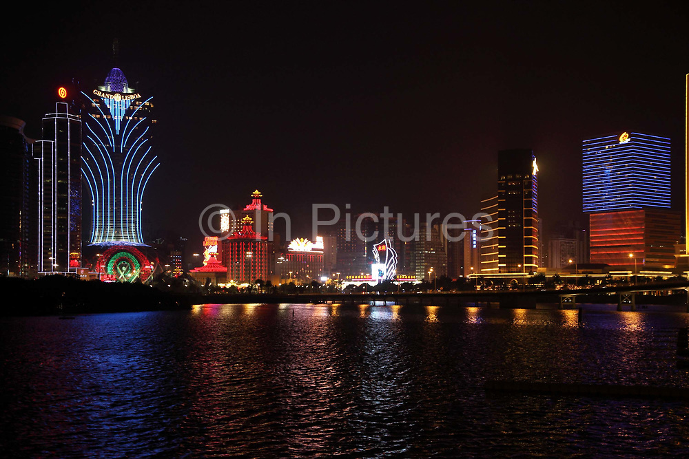 A view of the Macau city, with Stanly Ho's Grand Lisboa on the far left and Galaxy Entertainment Group's Starworld Casino on the far right, in Macau, China on 28 January 2011. A relative newcomer to the rapidly expanding Macau gambling scene, the Galaxy hopes its new casino will hold up its own against the likes of the Venetian, Wynn, MGM, and the Lisboa.
