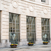 The exterior of the Woodrow Wilson Presidential Memorial Exhibit and Learning Center in the Ronald Reagan Building in downtown Washington DC. The Memorial commemorates the 28th American president. Etched into the glass are photographs of Woodrow Wilson.
