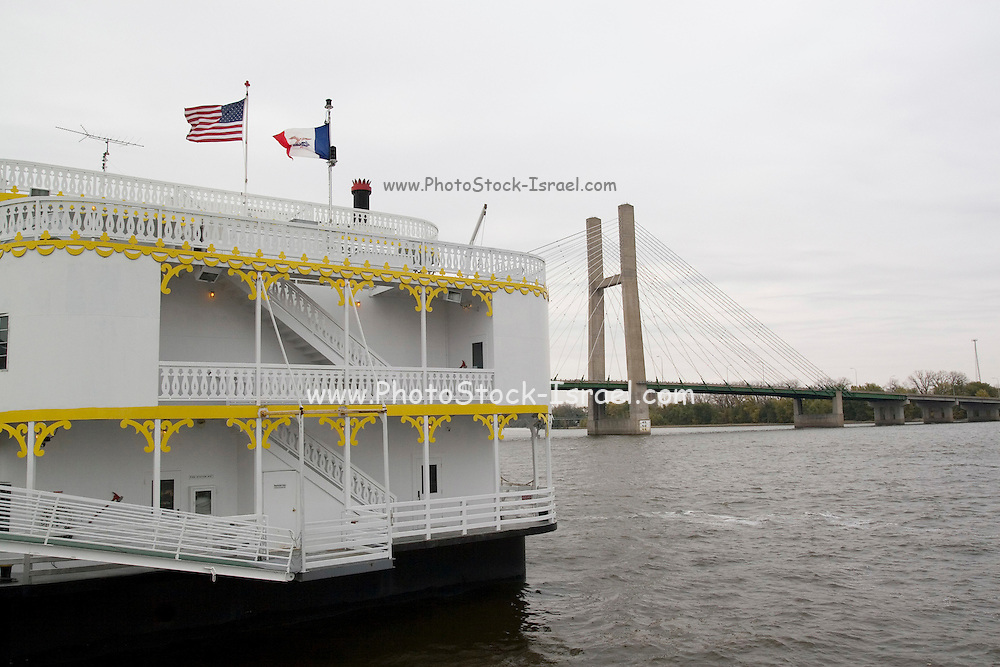 Iowa USA, A suspension bridge over the Mississippi between Burlington, IA and Gulf Port, IL A River paddle steamer  in the foreground
