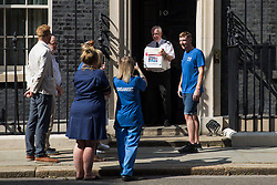 NHS Wales nurse Matthew Tovey (c) presents his NHSPay15 petition signed by over 800,000 people calling for a 15% pay rise for NHS workers at 10 Downing Street on 20th July 2021 in London, United Kingdom. At the time of presentation of the petition, the government was believed to be preparing to offer NHS workers a 3% pay rise in 'recognition of the unique impact of the pandemic on the NHS'.