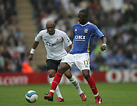 Photo: Lee Earle.<br /> Portsmouth v Bolton Wanderers. The FA Barclays Premiership. 18/08/2007.Portsmouth's John Utaka (R) is tracked by Bolton's El-Hadji Diouf