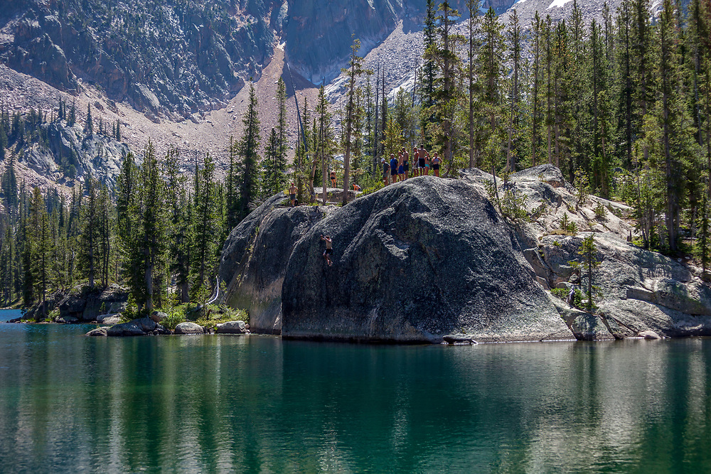 Cliff jumping into Shangri-La (Saddleback Lake) Lake at the base of the Elephant's Perch in the Sawtooth Mountains just above Redfish Lake near Stanley, Idaho.  Licensing and Open Edition Prints.